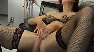 4:00: Two mature women masturbating on a couch